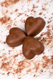 Three chocolate hearts Stock Photos