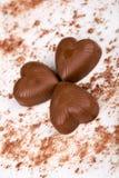 Three chocolate hearts stock photos
