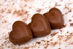 Three chocolate hearts on white background Stock Photo