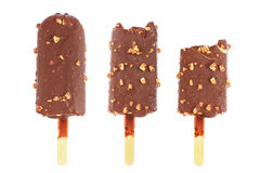 Three chocolate ice cream sticks with almond and bite isolated o Royalty Free Stock Image