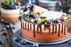 Three chocolate mousse cake decorated with waffle cone, fresh bl Stock Photo