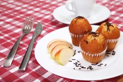 Three chocolate muffins served in restaurant Royalty Free Stock Photos