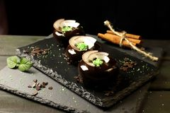 Three chocolate desserts with coconut chips royalty free stock images