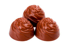 Three chocolate sweets Stock Image