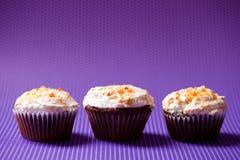 Three chocolate velvet cupcakes with vanilla ice cream topping Stock Photos