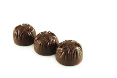 Three chocolates Stock Image