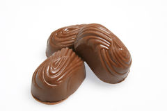 Three chocolates. Three little fine chocolates on isolated background Royalty Free Stock Photos