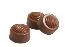 Three chocolates. Three little fine chocolates on isolated background Royalty Free Stock Photo