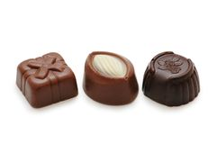 Three chocolates isolated Stock Photos