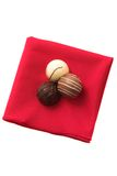 Three Chocolates on a red serviette Royalty Free Stock Photos