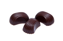 Three chokolate candies Stock Photos