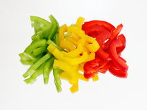 Three chopped peppers on the mirror Royalty Free Stock Photos