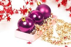 Three chrispmas purple balls Stock Image