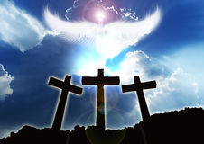 Three christian Crosses, angel rising beautifull clouds. Three christian crosses on the edge of a mountain with an angel rising through beautifull clouds Stock Image