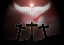 Three christian Crosses, angel rising dark background. Three christian crosses on the edge of a mountain with an angel rising from the darkness Stock Images