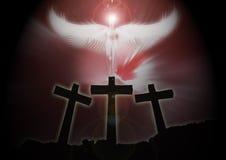 Three christian Crosses, angel rising dark background stock images