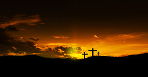 Three Christian crosses. Sun rising on three Christian crosses Stock Photo