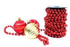 Three Christmas ball and beads Royalty Free Stock Images