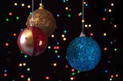 Three Christmas ball on a black Stock Photography
