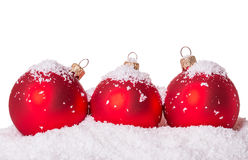 Three Christmas ball snow Royalty Free Stock Photos