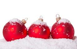 Three Christmas ball snow Royalty Free Stock Photos