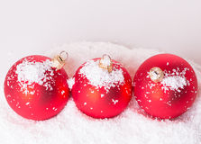 Three Christmas ball snow Stock Images