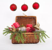 Three Christmas balls. Wooden box with Christmas gifts with green fir over white royalty free stock image