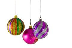 Three Christmas balls. Hanging over white background Stock Photography