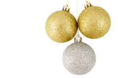 Three Christmas balls. Two golden, one silver Royalty Free Stock Photo