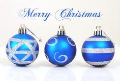 Three christmas balls. Isolated on white background Royalty Free Stock Photos