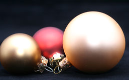Three christmas balls. Used for decorations on black background stock photos