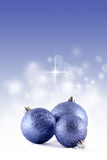 Three Christmas balls. Blue background Stock Images