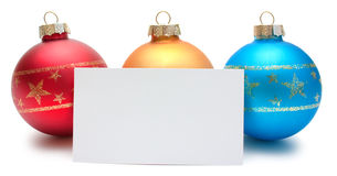 Three christmas balls with card Stock Photography