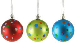 Three Christmas balls with colorful spots Stock Photos