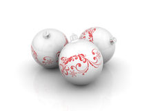 Three christmas balls with curls Royalty Free Stock Photography