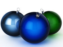 Three Christmas balls of different colors Stock Photo
