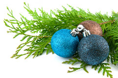 Three christmas balls with green leaves Royalty Free Stock Photos