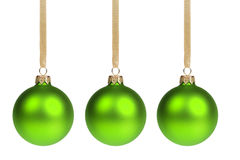 Three christmas balls hanging on ribbon Stock Image