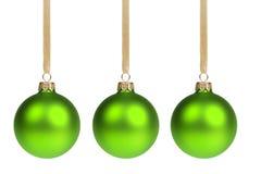 Three christmas balls hanging on ribbon stock image