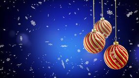 Three christmas balls hanging on ribbon on blue snow  Stock Photos