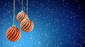 Three christmas balls hanging on ribbon on blue snow background. 4K stock video