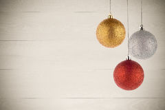 Three Christmas Balls Hanging Royalty Free Stock Photos