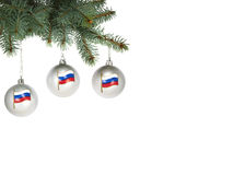 Three christmas balls with the image of the Russian state flag hanging on a christmas tree Stock Photo