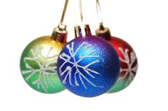 Three christmas balls isolated. On the white Royalty Free Stock Images