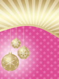 Three Christmas balls on a pink background Stock Images