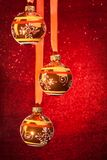 Three Christmas balls on red Royalty Free Stock Images