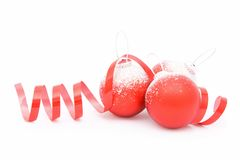 Three Christmas balls and a ribbon Stock Photography