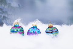 Three Christmas balls in a row Stock Photo