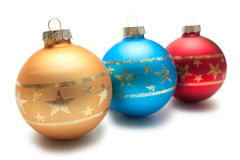 Three christmas balls in a row Stock Photography