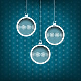 Three Christmas balls. Snow flakes decoration. Vintage style. Blue background Royalty Free Stock Image